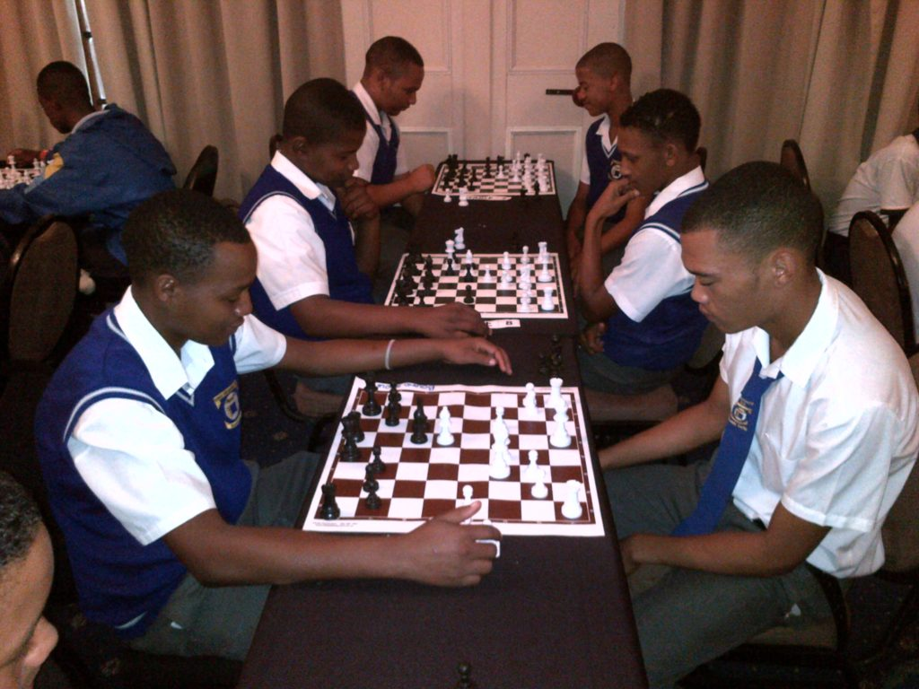High school boys playing chess at The Caledon